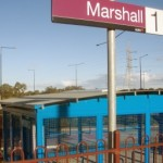 Parkiteer behind Marshall Station sign